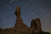 Balanced Rock against a backdrop of star trails in Arches National Park near Moab, Utah.
