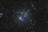 NGC 457 is an open star cluster in the constellation Cassiopeia. It contains nearly one hundred stars and lies over 9,000 light years away from the Sun.