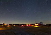 Amateur astronomers become active on a clear night at a star party in Crowell, Texas.