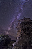 A rocky hoodoo stands against the night sky as the Milky Way sets near Black Mesa, Oklahoma.