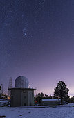 A defunct Air Force Station radar tower still stands at Mount Lemmon Observatory near Tucson, Arizona. The constellation Orion floats above this remnant from the Cold War.