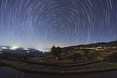 Polar star trails circle around the north celestial pole above Honghe Hani Rice Terraces, a world heritage sites in southwest China. The Honghe Hani Rice terraces cascade down the towering slopes of the Ailao Mountains, carved out of dense forest over the past 1,300 years by Hani people. The irrigated terraces support paddy fields overlooking narrow valleys. In some places there are as many as 3,000 terraces between the lower edges of the forest and the valley floor.