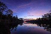Break of dawn at Angkor Wat in Cambodia. Venus and Moon are getting close in the morning twilight.