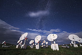 The Milky Way appear among the passing clouds above Mingantu CSRH Station in Inner Mongolia, China. The Chinese Spectral RadioHeliograph (CSRH) is a state-of-the-art imaging telescope array, which will operate at centimeter and decimeter wavelengths (0.40 - 15.00 GHz). It has 100 antennas with diameters of 2.0 and 4.5 m in a 3-arm spiral array. It will obtain full imaging observations of the solar chromosphere and corona by using aperturesynthesis technology.