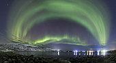 January 7, 2019 - An aurora borealis dances above the Arctic Ocean from Teriberka, Murmansk, Russia.