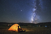 A camping site under the gorgeous Milky Way in Tibet, China.