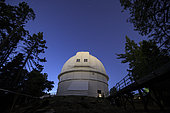 Stars shine above the 100-inch (2.5 m) Hooker telescope at Mount Wilson Observatory, California, USA.