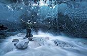 Self-portrait under a glacier in Alaska.