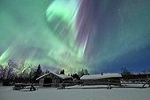 Northern lights above an old cabin in Yukon, Canada.
