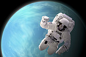 Artist's concept of an astronaut floating in outer space. A water covered planet is illuminated by a nearby star.