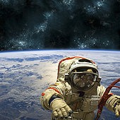 A cosmonaut floats in space above Earth. Stars shine in the background.