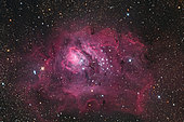 The Lagoon Nebula is a bright, diffuse nebula in the southern constellation Sagittarius; cataloged as M8 or NGC 6526. It contains a number of Bok globules, dark, collapsing clouds of protostellar material as well as a structure at its center known as the Hourglass Nebula.