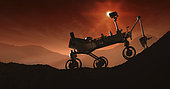 The Martian sun sets behind Curiosity as it struggles up the rugged slopes of Mount Sharp. If it succeeds in its climb, the rover will have completed the longest, highest extraterrestrial mountaineering journey ever attempted.