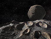 The asteroid Ida, viewed at close range by the Galileo spacecraft, was discovered to have a tiny moon, Dactyl, orbiting it. In this view Dactyl hovers in the sky of Ida.