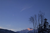 January 5, 2005 - Moon and Alpenglow, New Aiyansh, British Columbia, Canada.