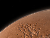 Mars' Valles Marineris is host to the largest canyons in the Solar System. The canyons are as long as the United States is wide with some parts five times deeper than the Earth's Grand Canyon. . This image is looking west over a complex of canyons known as the Noctis Labyrinthus. Further west on the horizon are three large volcanoes known collectively as the Tharsis Montes. Though each volcano towers 9 miles above the plains, from this orbital perspective they appear as mere bumps. From left to right the volcanoes are Arsia Mons, Pavonis Mons and Ascraeus Mons.