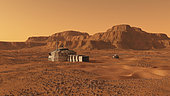 A manned habitat rests on the rocky and desolate surface of Mars. In the background is a mesa and on the right a manned rover.