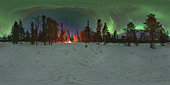 360 panorama of an aurora over the winter forest with glowing tent in the Kola Peninsula, Russia.