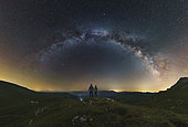 A couple gazing at the Milky Way from atop the Lago-Naki plateau overlooking Russia.