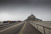 Tourists waiting for the shuttle at Mont Saint-Michel, Normandy, France