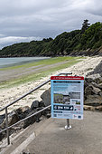Sign warning of the danger of decaying green algae on the beach of Binic, Côtes d'Armor, Brittany, France