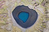 Aerial view, a blue crater lake surrounded by moss-covered mountains, southern coast of Iceland, Iceland, Europe