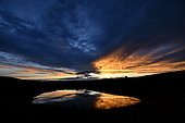 Cloud formations reflecting on a body of water at sunset, Brognard, France