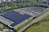 Installation of a solar panel shade on a car park, Peugeot factory, along the A36 motorway, Sochaux, France