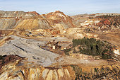 Dramatically scarred landscape of mineral-rich ground and rock at the Rio Tinto mines. Huelva province, Andalusia, Spain.