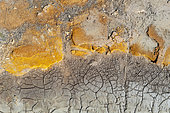 Detail at the shore of the Río Tinto (Red river). Its colour is caused by oxidised iron minerals. Aerial view. Drone shot. Huelva province, Andalusia, Spain.
