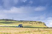 Farmer stubble ploughing his field, Côte d'Opale, Pas de Calais, France