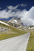 Mountain Landscape, view of the Corno Grande with a road in the foreground, Abruzzo, Italy