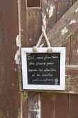 Message written on a slate in a garden, summer, Pas de Calais, France
