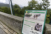 Information panel overlooking a wildlife park where it is possible to observe captive-born and injured Italian wolves in the village of Civitella Alfedena, Abruzzo National Park, Italy