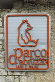 Sign of the Abruzzo National Park with its emblem, the Marsican brown bear (Ursus arctos marsicanus), Italy
