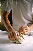 hands kneading the dough