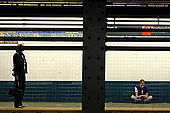 A views about the metros world. moviments and isolation are the key  to read this places-New York-