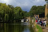 United Kingdom London Regent's Canal Hiking along the canal in the nearest of the Victoria Park and the Old Ford lock in background.