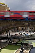 United Kingdom London Regent's Canal Limehouse Basin - The Commercial Road Lock and the railway.