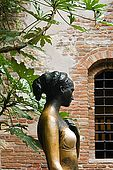 A bronze statue of Juliet by Nereo Constantini stands in the courtyard of Juliet's house, Verona, Veneto, Italy. The statue was donated by the Lion's Club. Juliet's right breast has been rubbed clean over the years by tourists placing their hand there.