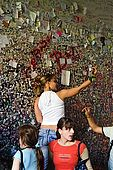 Girls leaving love messages at the entrance to Juliet's House, Verona, Veneto, Italy