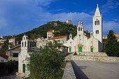 Croatia Lastovo Island Lastovo village - The main square with the Sv Kuzma i Damjan church at right and Sv Marija church at left and the Kastel in background, over the hill..