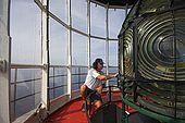 Croatia Lastovo Island Struga lighthouse - Jure, the lighthouse-keeper, checks the lamp.