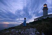 Croatia - Lastovo island - Skrivena bay - Struga lighthouse - Nada Kvinta, lighthouse-keeper wife, looking at the panorama at dusk.