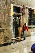 Reflection in the window of Antico Bar, Bassano del Grappa, Veneto, Italy. tel: 0424 521161