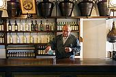 Barman pours a grappa in the Nardini bar. The bar has hardly changed since it opened in 1779. Bassano del Grappa, Veneto, Italy