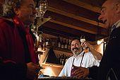 Lele, the jovial host of Bar Breda, raises his own glass behind the bar. Bassano del Grappa, Veneto, Italy. tel: 0424 522123