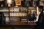 Barman prepares Spritz aperitives in the Nardini bar. The bar has hardly changed since it opened in 1779. Bassano del Grappa, Veneto, Italy