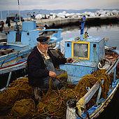 Fisher man at Skala Kallonis, Lesvos, Greece