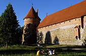 Trakai, Lithuania: chatting in front of the left side of the peninsukar castle (Traky pilis);